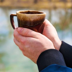 Image of hands cradling coffee cup