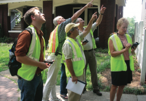 image of people learning to identify tree pests
