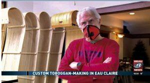 Image of Steve Vogelsang in workshop with toboggans