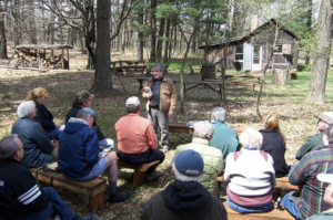 Image of tour group seated outside the Leopold shack.